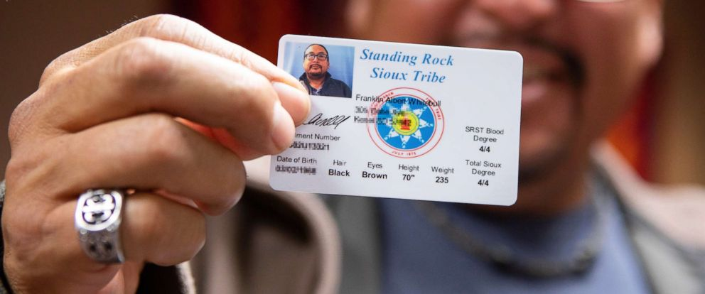 PHOTO: Frank White Bull, a Standing Rock Sioux council member, shoes his tribal identification card, complete with physical address, in North Dakota, Oct. 22, 2018.