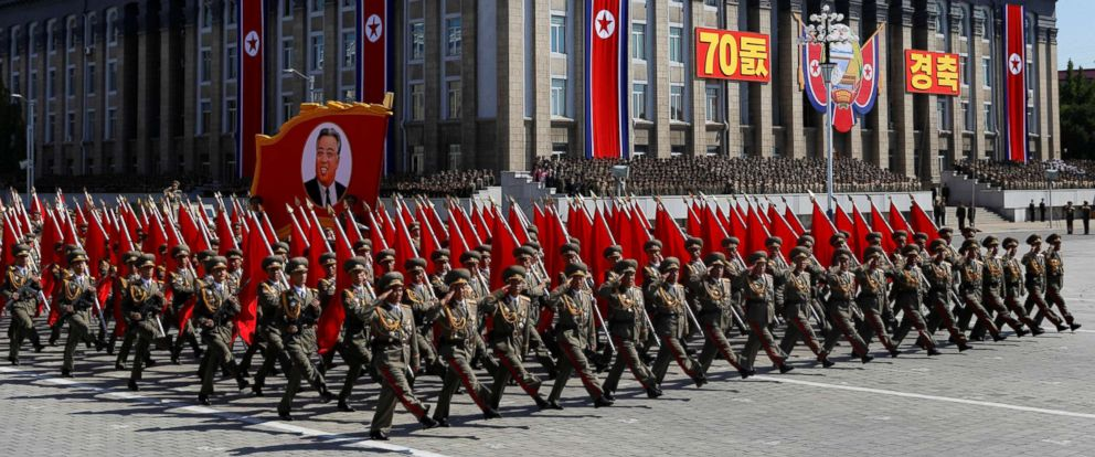 PHOTO: Soldiers march with the portrait of North Korean founder Kim Il Sung during a military parade marking the 70th anniversary of countrys foundation in Pyongyang, North Korea, Sept. 9, 2018.