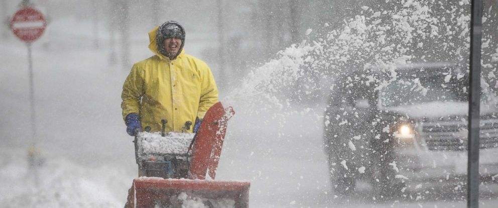 PHOTO: A worker uses a snowblower on Clarendon St. as the third noreaster hits the area in less than two weeks, March 13, 2018, in Boston.