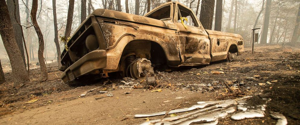 PHOTO: A burned pick-up truck rests on Pearson Rd. after the wildfire burned through Paradise, Calif., on Saturday, Nov. 10, 2018.