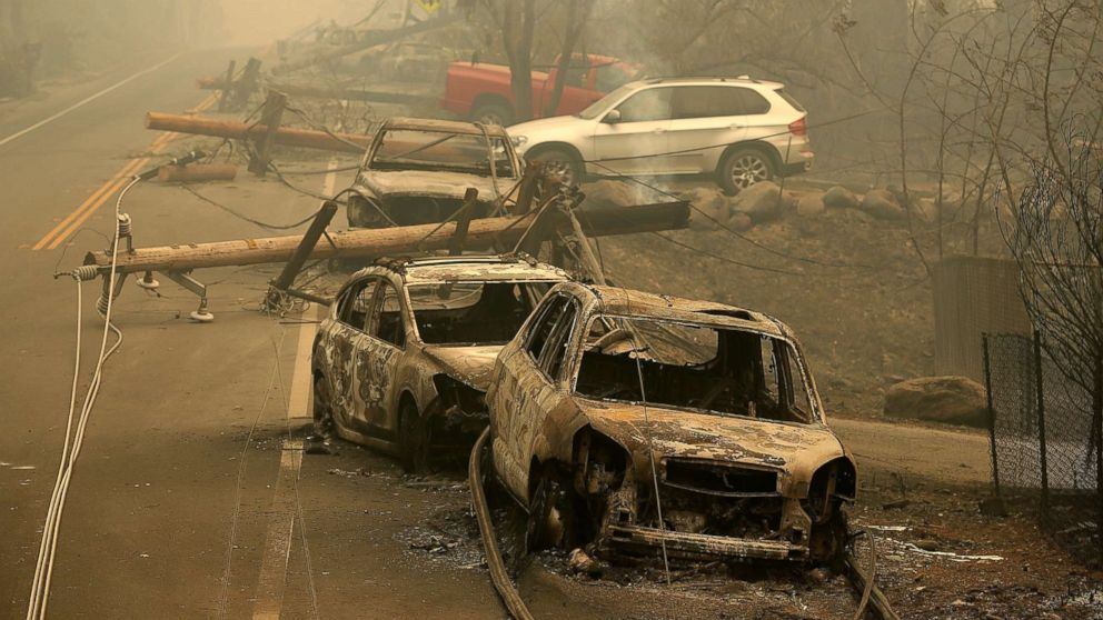 Power lines rest on cars that were burned by the Camp Fire on Nov. 10, 2018 in Paradise, Calif.