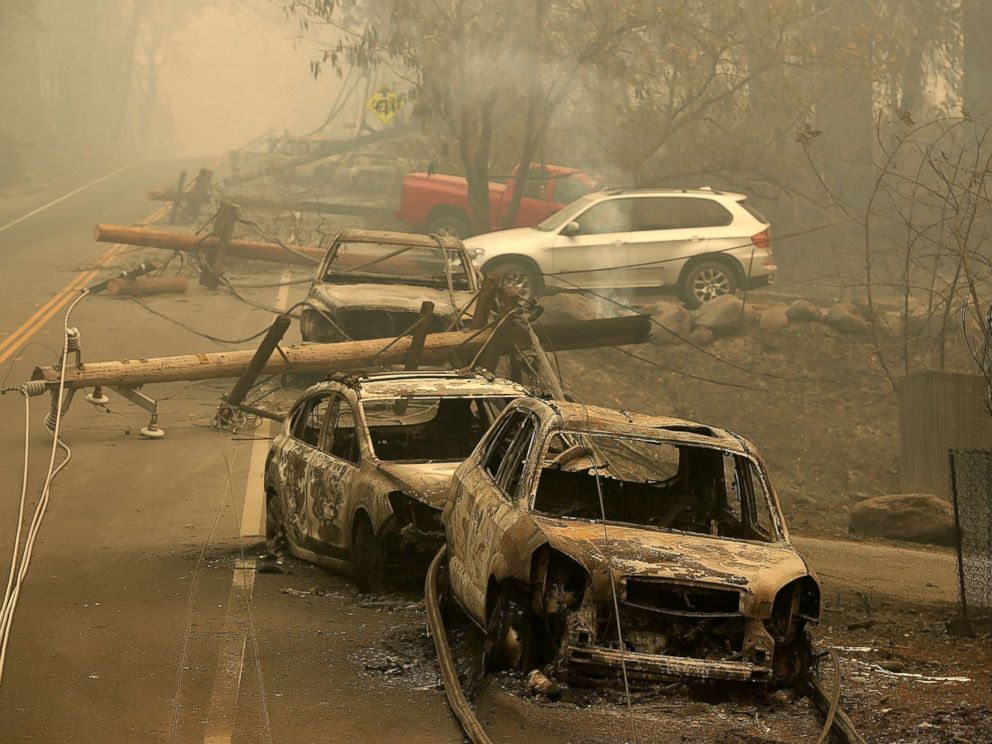 PHOTO: Power lines rest on cars that were burned by the Camp Fire on Nov. 10, 2018 in Paradise, Calif.
