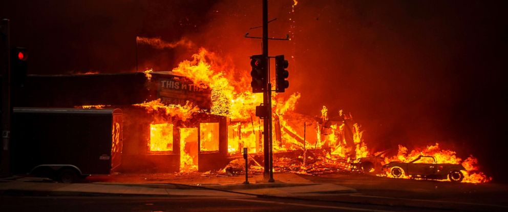 PHOTO: A store burns as the Camp fire tears through Paradise, Calif., Nov. 8, 2018.