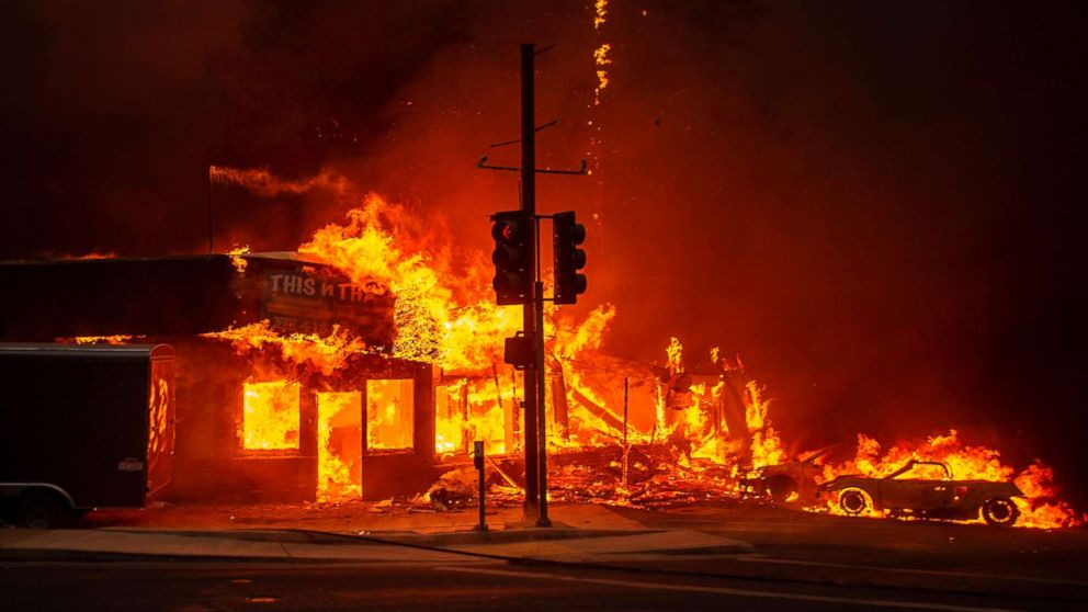 A store burns as the Camp fire tears through Paradise, Calif., Nov. 8, 2018.