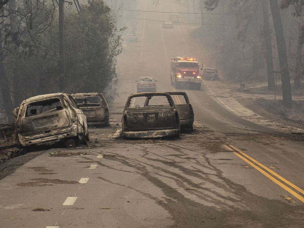 PHOTO: Abandoned vehicles that were burned as residents of Paradise scrambled to escape the Camp Fire sit on Pearson Road, Nov. 8, 2018.