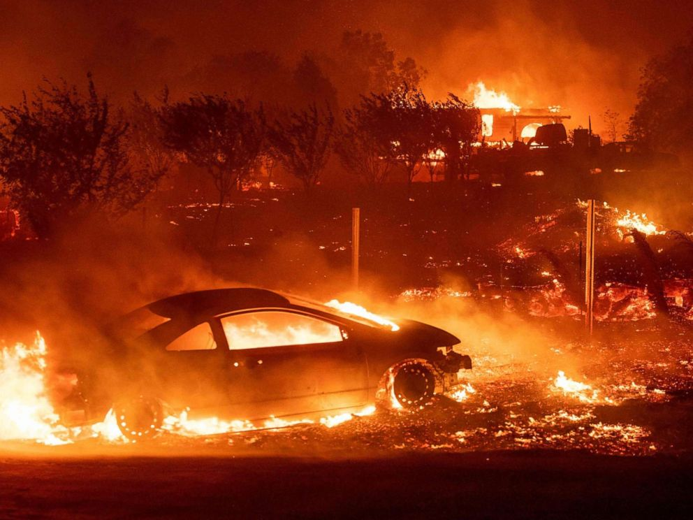PHOTO: Vehicles and homes burn as the Camp fire tears through Paradise, Calif., on Nov. 8, 2018.