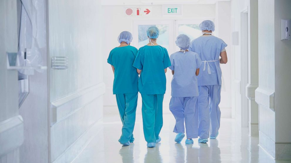 A rear view of four medical staff wearing scrubs is seen in this undated stock photo.