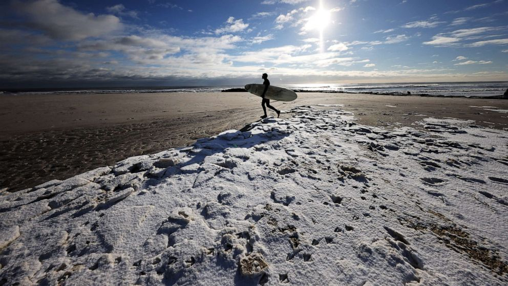 Heavy snow hits Northeast as California sees record heat, critical fire danger