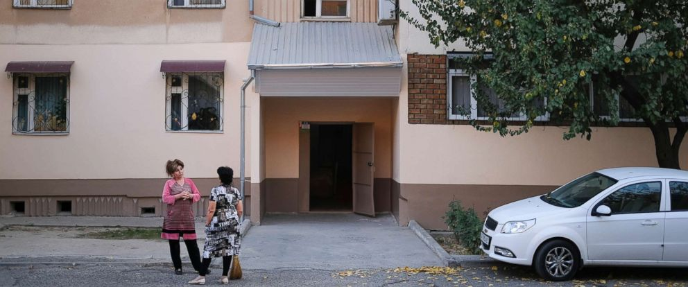 PHOTO: Local residents stand outside the apartment block where the suspect in the terrorist attack in New York, Sayfullo Saipov lived between 1996-2006, according to police records, in Tashkent, Uzbekistan, Nov. 1, 2017.