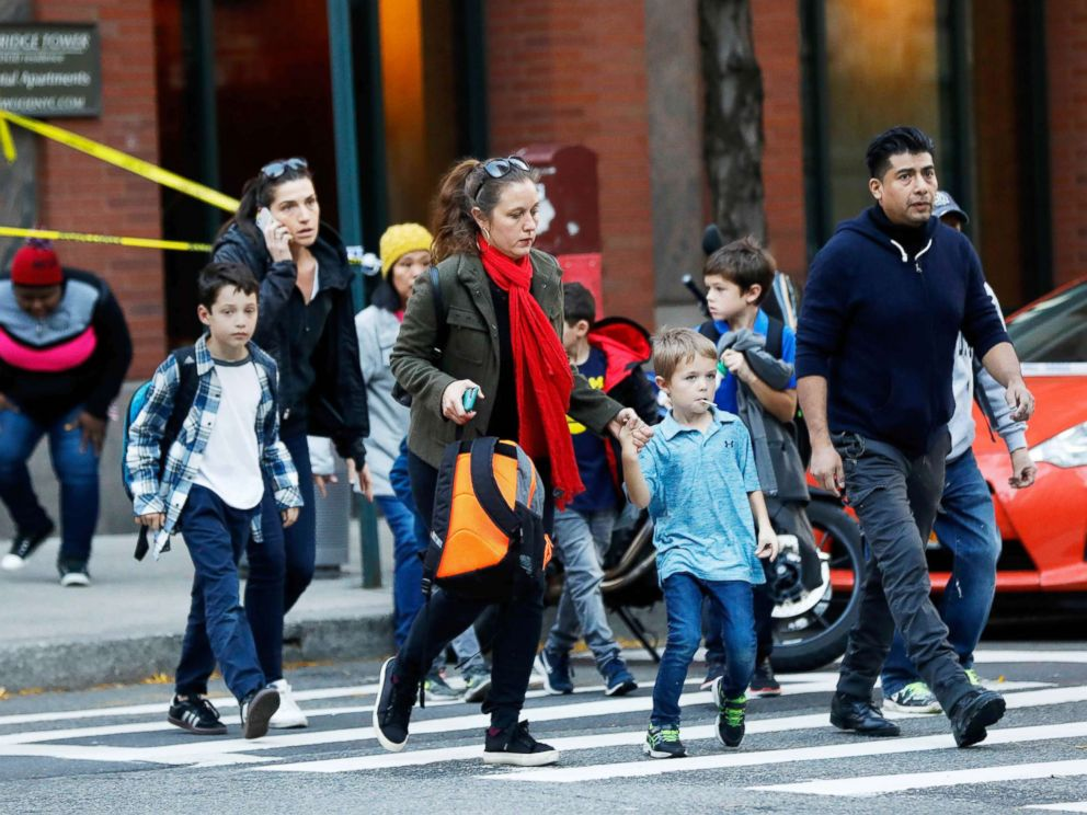 PHOTO: Parents pick up their children from P.S./I.S.-89 school after a truck struck people on a bike path in New York City, Oct. 31, 2017.