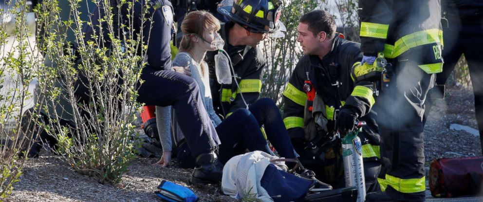 PHOTO: A woman is aided by first responders after sustaining injury on a bike path in lower Manhattan in New York, NY, Oct. 31, 2017.