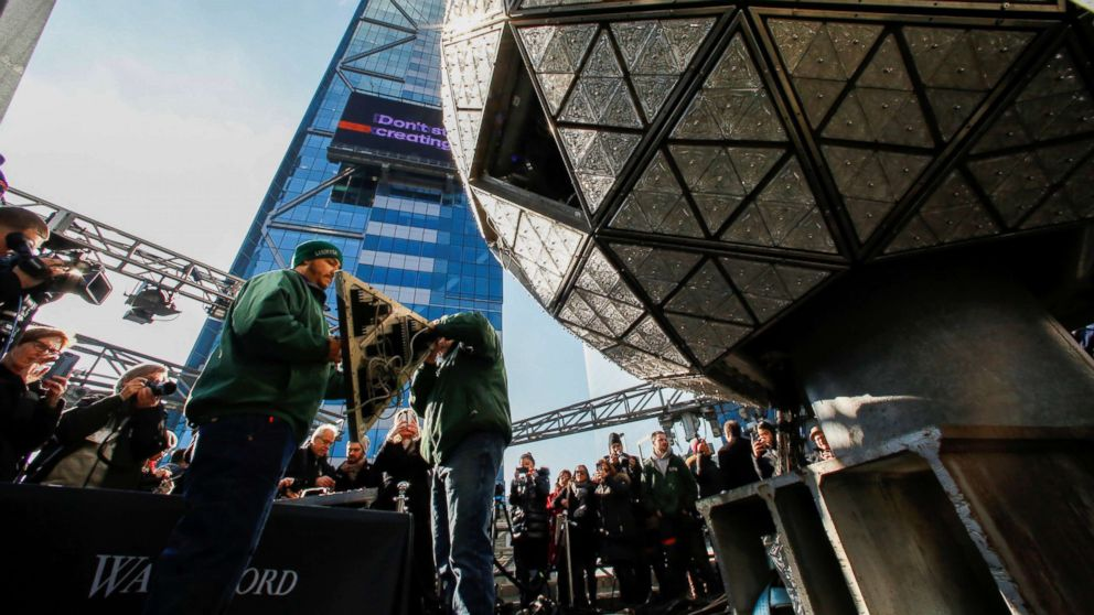 Workers get ready to install Waterford Crystal triangles on the Times Square New Year's Eve Ball on the roof of One Times Square in the Manhattan borough of New York, Dec. 27, 2018.
