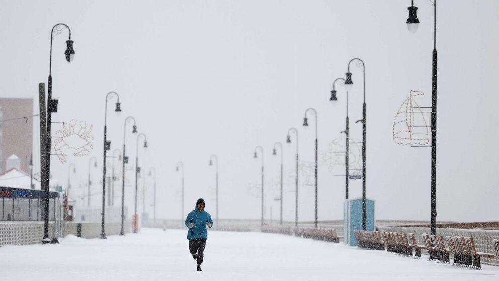 PHOTO: A man runs along the boardwalk on Dec. 17, 2020, in Long Beach, New York.