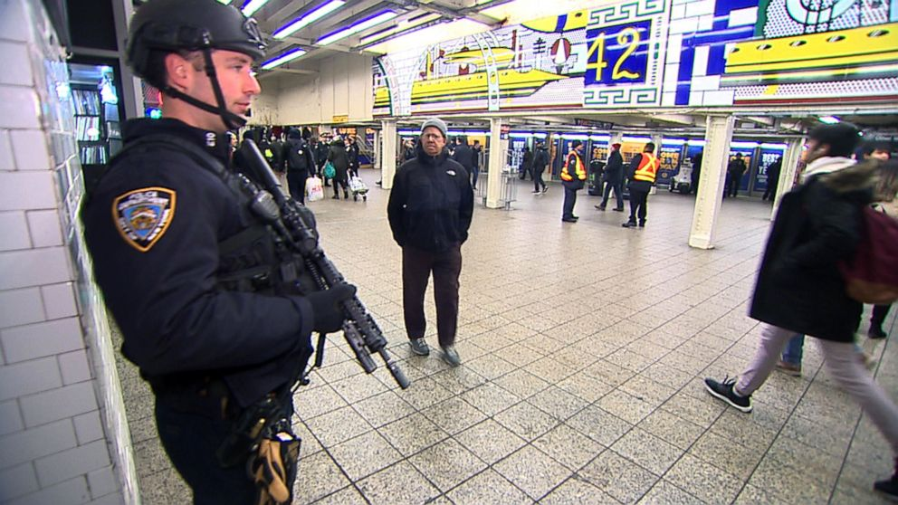 PHOTO: New York police watch over the subway station at Times Square in New York.