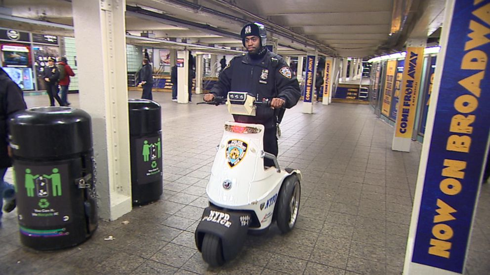 PHOTO: New York police patrol by scooter in the subway station near Times Square, New York.