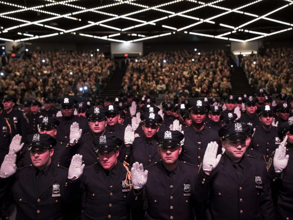 PHOTO: The newest members of the New York City Police Department are sworn-in during their police academy graduation ceremony at the Theater at Madison Square Garden, April 18, 2018 in New York.