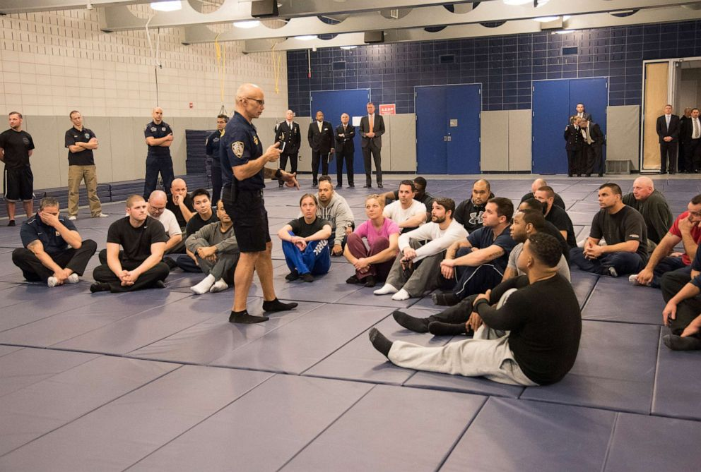 PHOTO: In this file photo, New York City Mayor Bill de Blasio and NYPD Commissioner Bill Bratton watch a demonstration of new police guidelines that will be taught to police officers at the Police Academy on December 4, 2014 in New York.