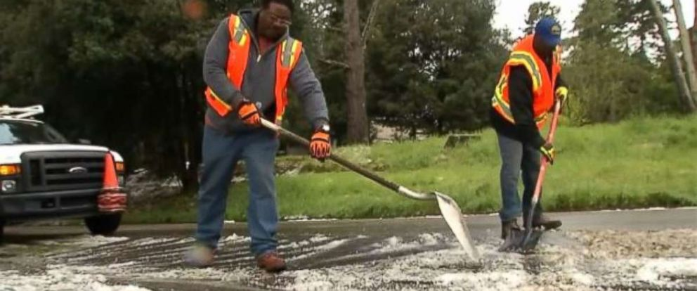 Crews in Oakland, Calif., were left to shovel hail off the streets after a storm rolled through on Monday, April 16, 2018.