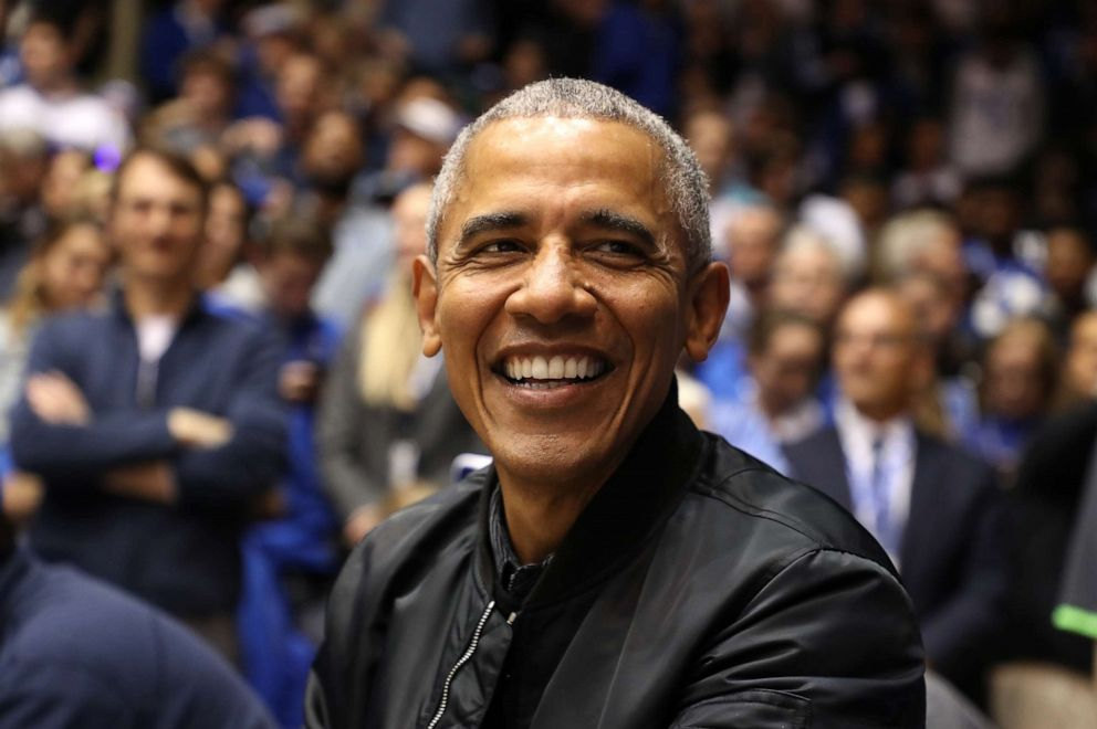 PHOTO: Former President of the United States, Barack Obama, watches on during the game between the North Carolina Tar Heels and Duke Blue Devils at Cameron Indoor Stadium on February 20, 2019 in Durham, North Carolina.