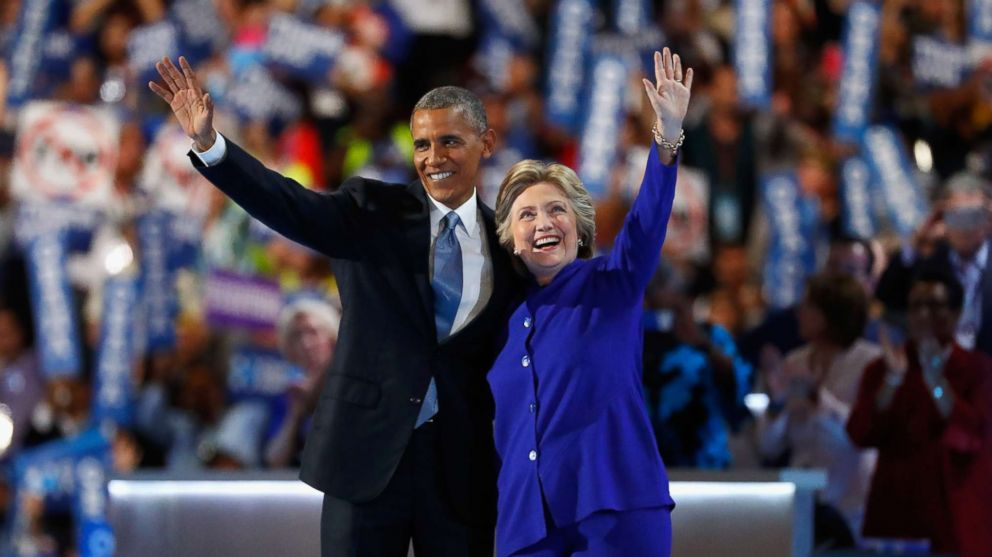 President Barack Obama and Democratic presidential nominee Hillary Clinton acknowledge the crowd on the third day of the Democratic National Convention at the Wells Fargo Center, July 27, 2016 in Philadelphia.