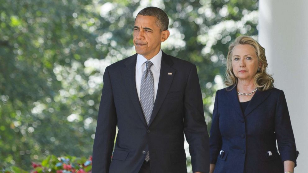 President Barack Obama and Secretary of State Hillary Clinton make their way to deliver a statement in the Rose Garden of the White House, Sept. 12, 2012 in Washington.