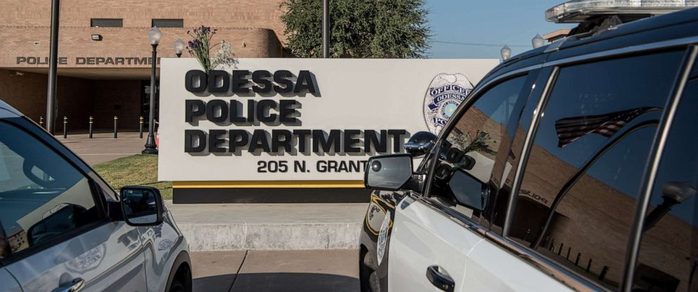 PHOTO: ODESSA, TX - SEPTEMBER 1: Flowers hang on the Odessa Police Department sign following a deadly shooting spree on September 1, 2019 in Odessa, Texas.