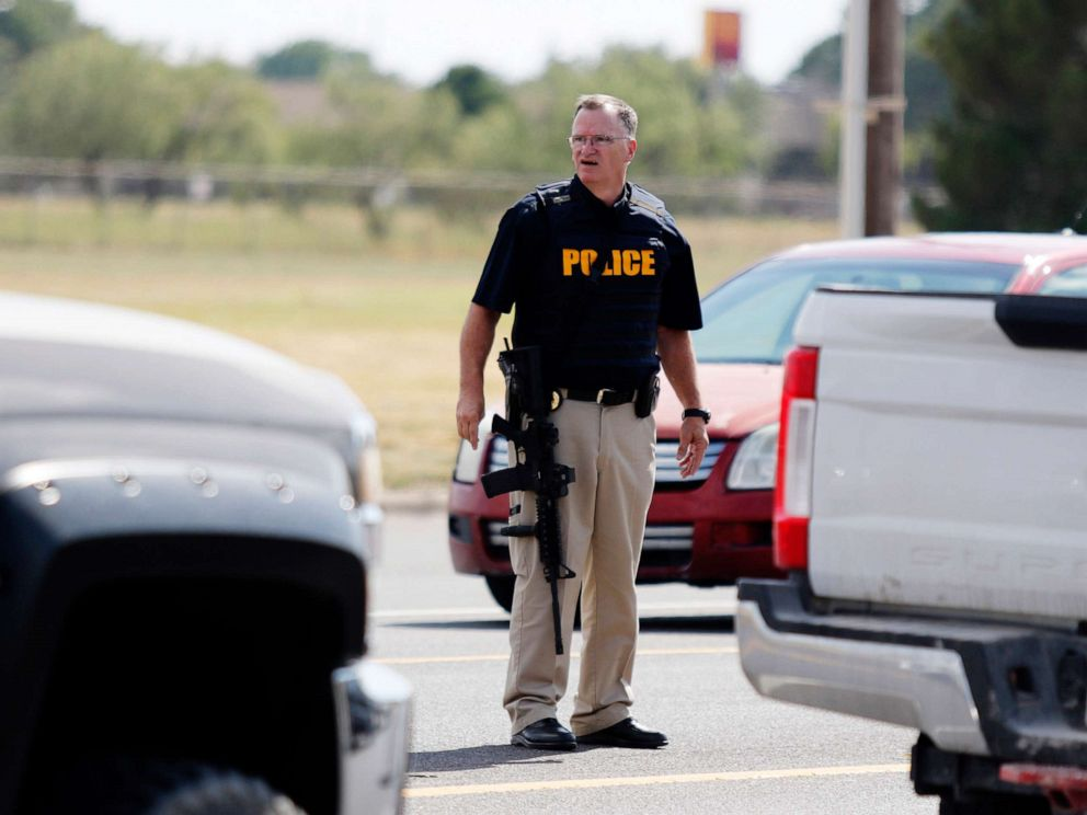 PHOTO: A law enforcement officer stands in the middle of the 5100 block of E. 42nd Street in Odessa, Texas, Aug. 31, 2019, following a shooting.