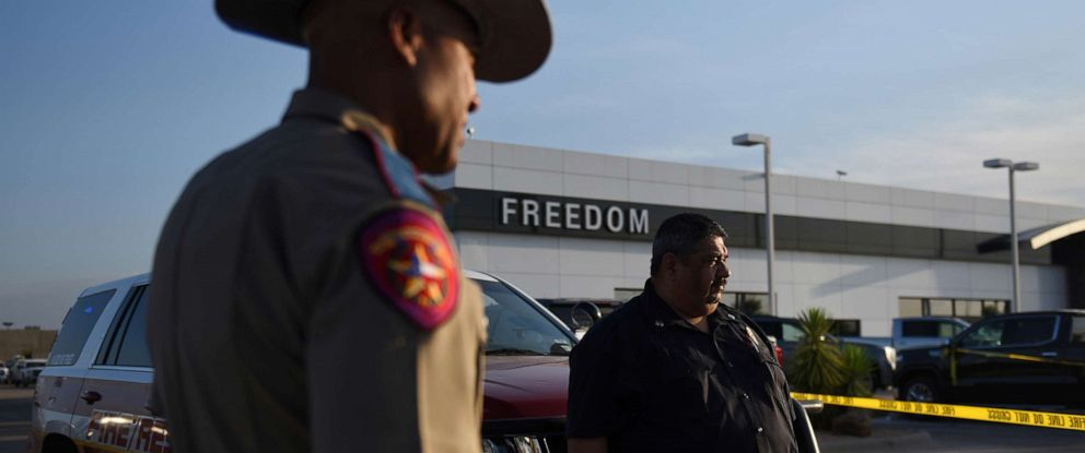 PHOTO: A Texas state trooper and other emergency personnel monitor the scene at a local car dealership following a shooting in Odessa, Texas, Sept. 1, 2019.