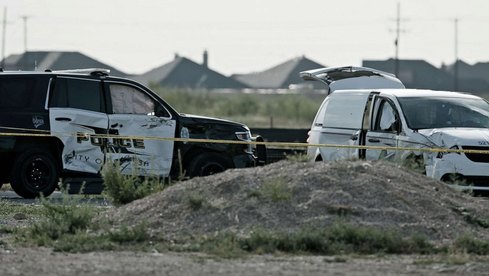PHOTO: A city of Odessa police car, left, and a U.S. mail vehicle, right, which were involved in Saturdays shooting, are pictured outside the Cinergy entertainment center, Sept. 1, 2019, in Odessa, Texas.