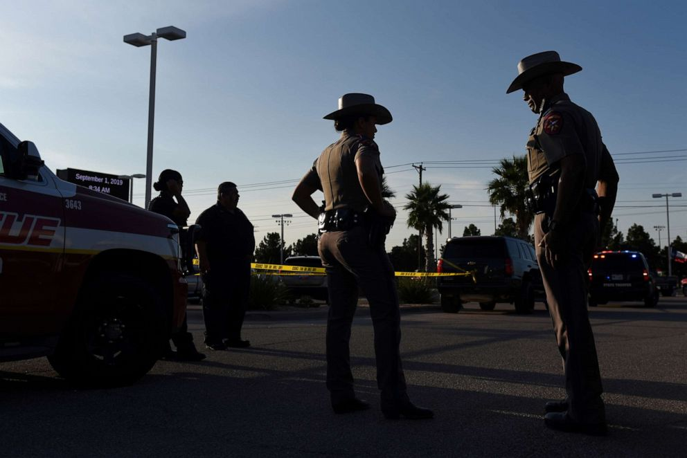 PHOTO: Texas state troopers and other emergency personnel monitor the scene at a local car dealership following a shooting in Odessa, Texas, Sept. 1, 2019.
