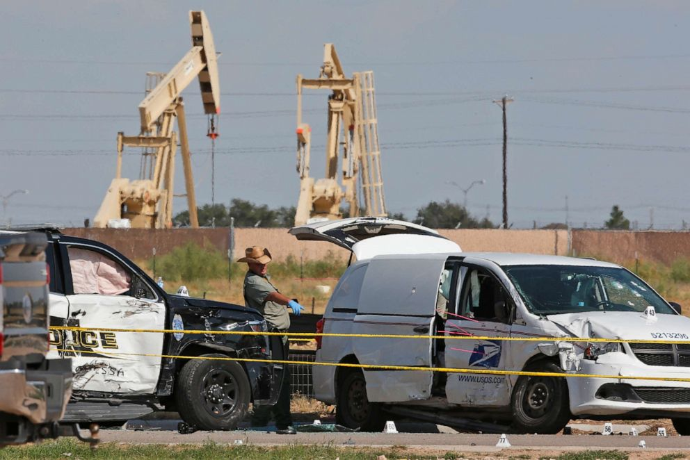 PHOTO: Law enforcement officials process the crime scene from a shooting rampage which ended with the shooter being shot dead by police in a stolen mail van, right, in Odessa, Texas, Sept. 1, 2019.