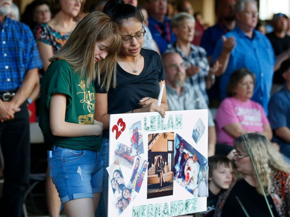 PHOTO: High School students Celeste Lujan, left, and Yasmin Natera, right, mourn their friend, Leila Hernandez, one of the victims of the Saturday shooting in Odessa, at a memorial service Sunday, Sept. 1, 2019, in Odessa, Texas.