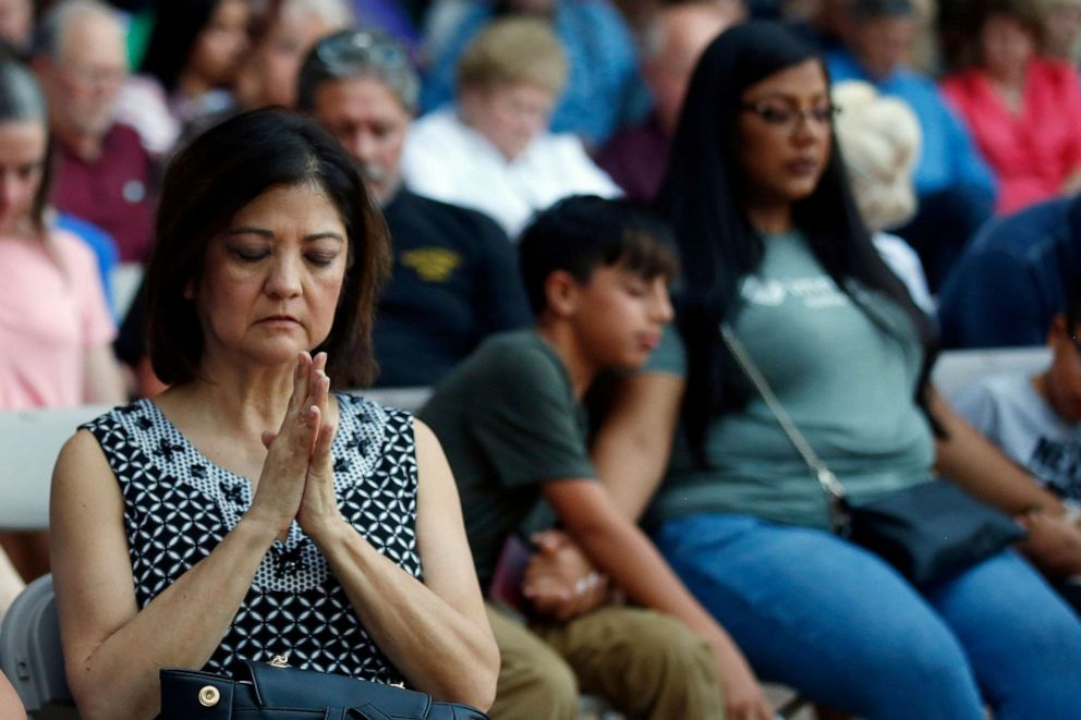 PHOTO: Mira Marquez, of Midland, Texas, folds her hands in prayer during a prayer service, Sunday, Sept. 1, 2019, in Odessa, Texas, for the victims of a shooting spree the day before.