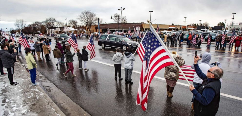 PHOTO: Residents support American flags in honor of Provo Police Officer Joseph Shinners body in the future of a procession in Provo, Utah, Jan. 6, 2019.