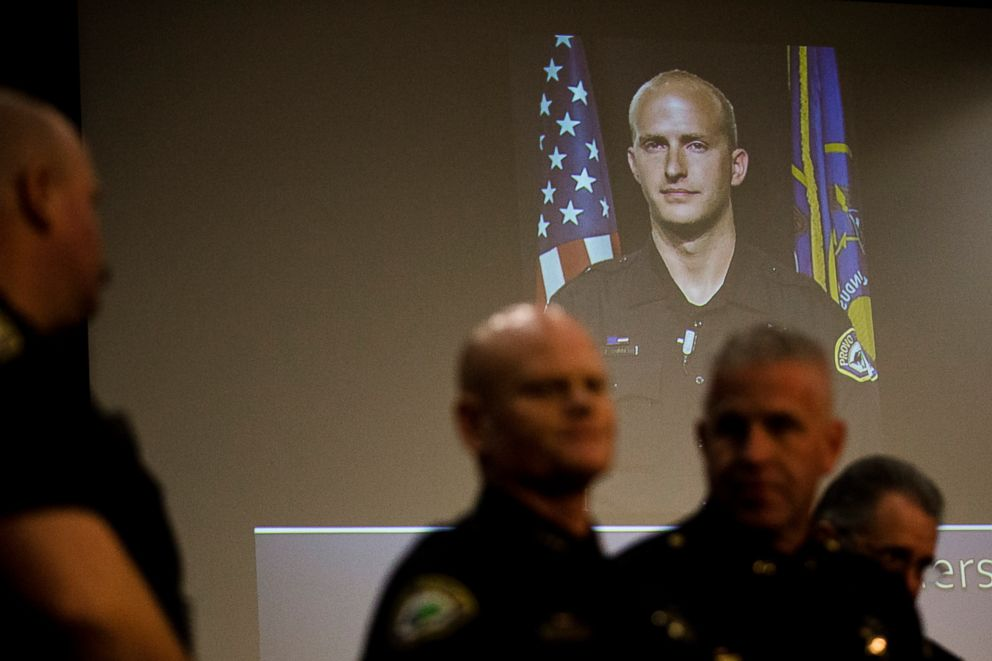 PHOTO: A image of Joseph Shinners, a Provo police officer who became as soon as killed in the line of duty, is projected at the Provo Metropolis Center building in the future of a data convention on Sunday, Jan. 6, 2019, in Provo, Utah.