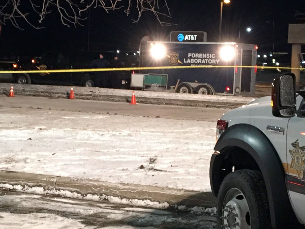 PHOTO: Investigators are pictured at the scene in Saginaw Township, Mich., where a police officer was shot during a traffic stop early on Jan. 22, 2019.