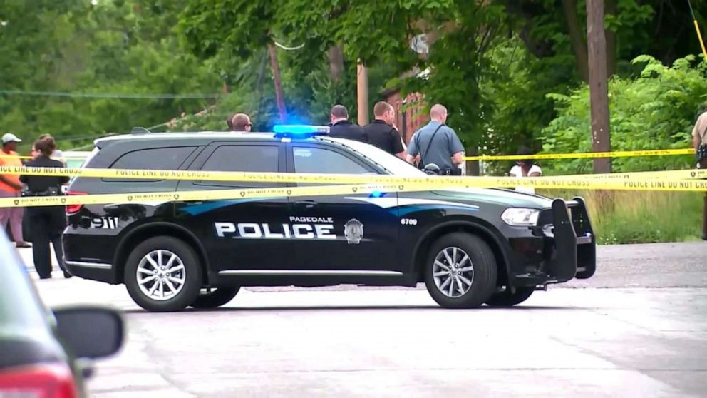 PHOTO: Law enforcement officers congregate at the scene in Wellston, Mo., where North County Police Cooperative Police Officer Michael Langsdorf was shot and killed, June 24, 2019.