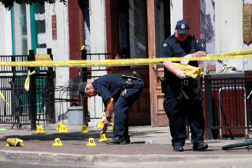 PHOTO: Authorities retrieve evidence markers at the scene of a mass shooting, Aug. 4, 2019, in Dayton, Ohio.