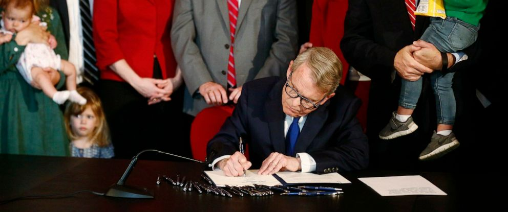 PHOTO: Gov. Mike DeWine speaks before signing a bill imposing one of the nations toughest abortion restrictions, April 11, 2019 in Columbus, Ohio.