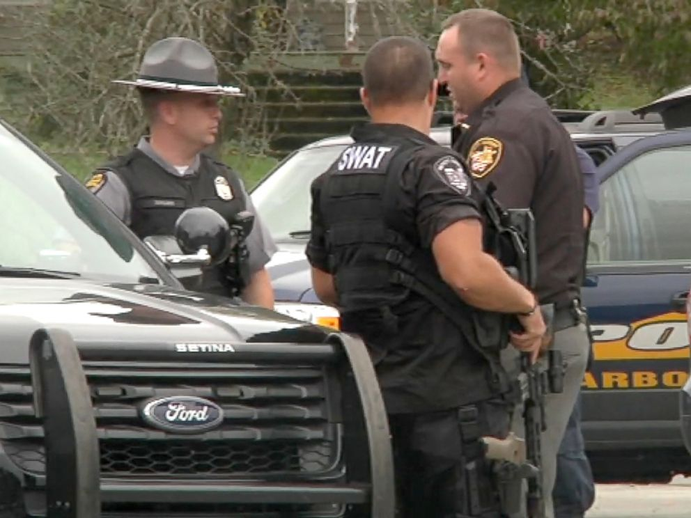 PHOTO: Police gather at the scene of a murder where four people were killed in Lawrence County, Ohio.