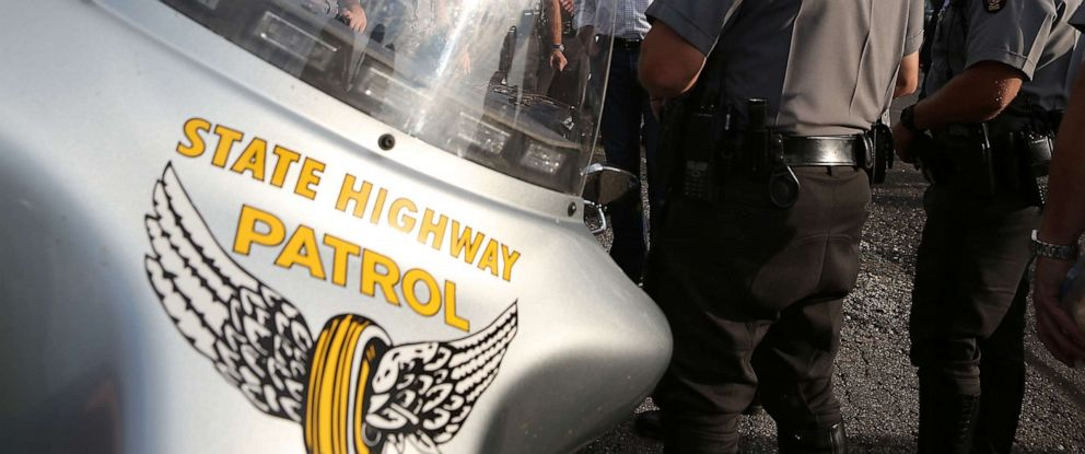 PHOTO: Ohio State Highway Patrol officers are pictured in Tarlton, Ohio, Aug. 14, 2012.