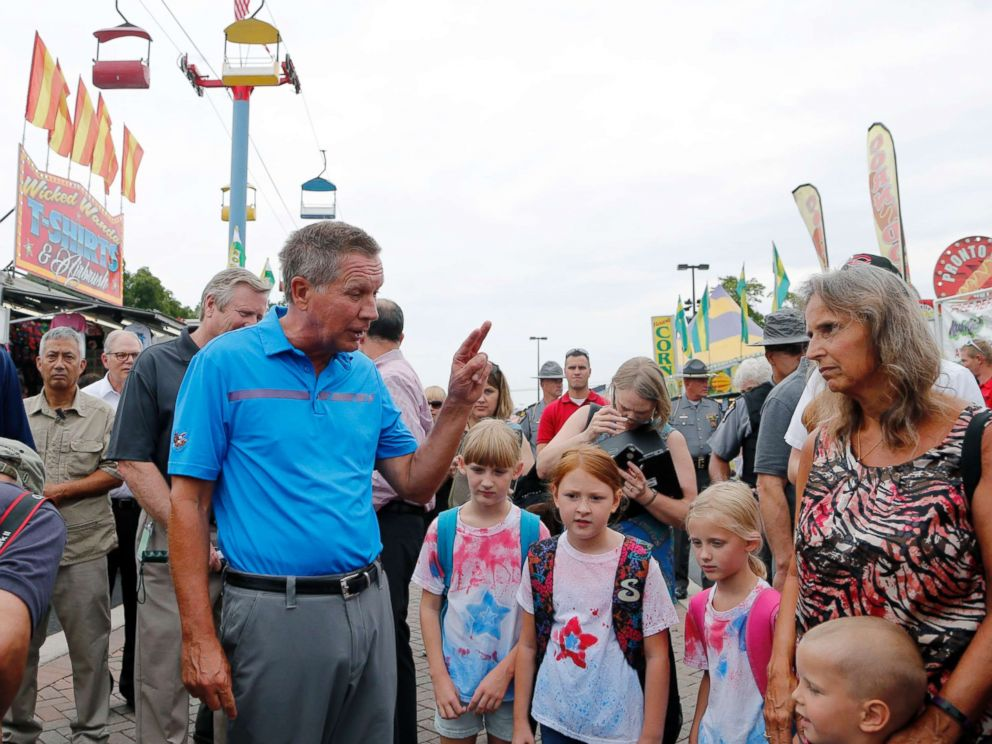 PHOTO: Ohio Gov. John Kasich talks with fairgoers while he tours the Ohio State Fair, Thursday, July 27, 2017, in Columbus, Ohio.