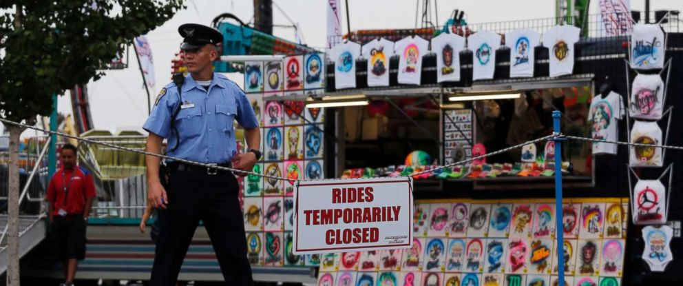PHOTO: An Ohio State Highway Patrol cadet patrols the midway at the Ohio State Fair, July 27, 2017, in Columbus, Ohio.