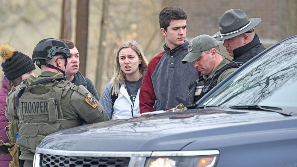 Students from Ohio State University Mansfield answer questions from law enforcement Monday afternoon, Feb. 11, 2019, after a student was abducted on campus.Abduction 01