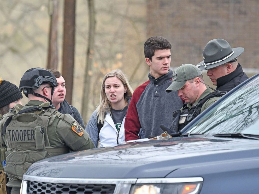 PHOTO: Students from Ohio State University Mansfield answer questions from law enforcement Monday afternoon, Feb. 11, 2019, after a student was abducted on campus.