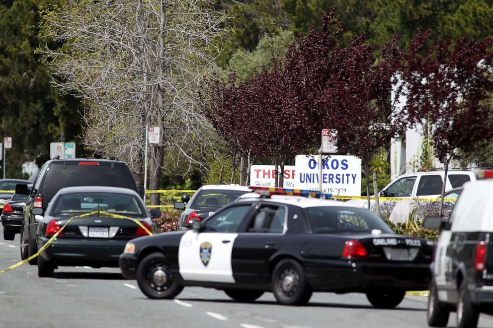 PHOTO: Police secure the scene at Oikos University after a shooting that killed multiple people, April 2, 2012, in Oakland, Calif.