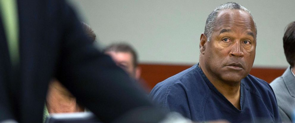PHOTO: O.J. Simpson listens as his defense attorney, Ozzie Fumo, questions witness David Cook during an evidentiary hearing in Clark County District Court, May 16, 2013, in Las Vegas.