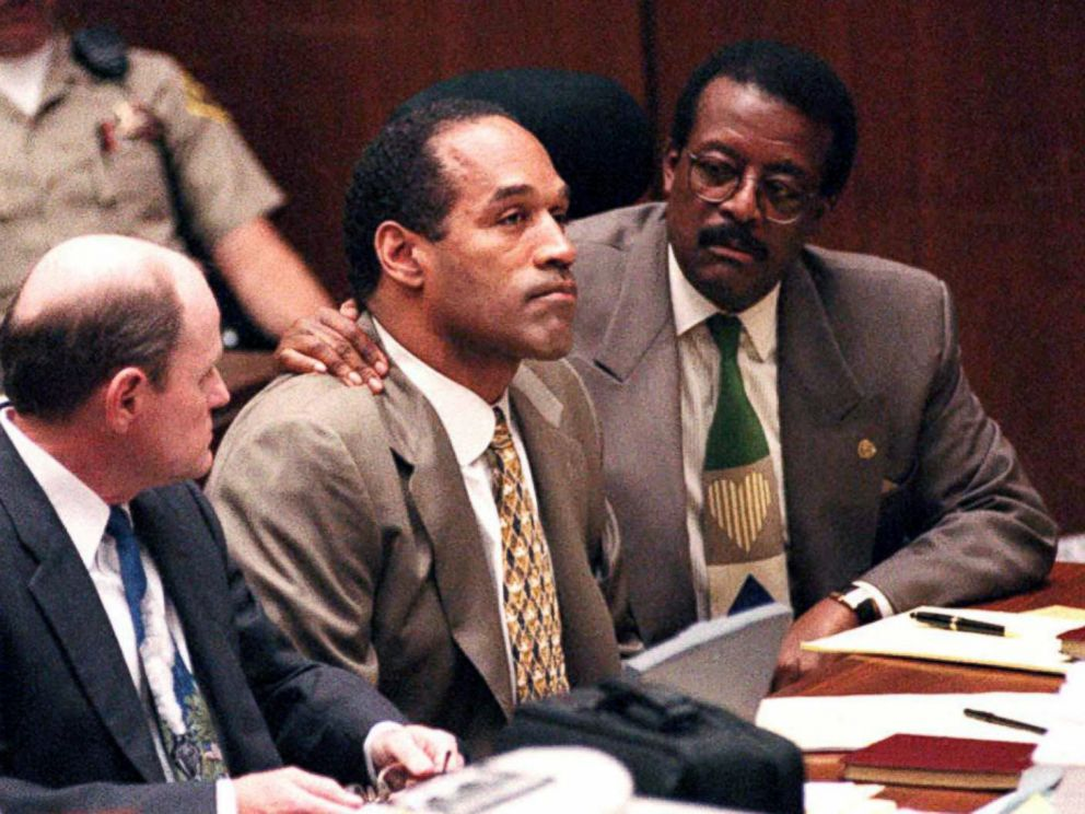 PHOTO: Johnnie Cochran puts his arm on O.J. Simpsons shoulder after Simpson told Judge Lance Ito that he has faith that jurors will acquit him of the murder of his ex-wife Nicole Simpson and her friend, Ronald Goldman, Sept. 22, 1995, in Los Angeles.