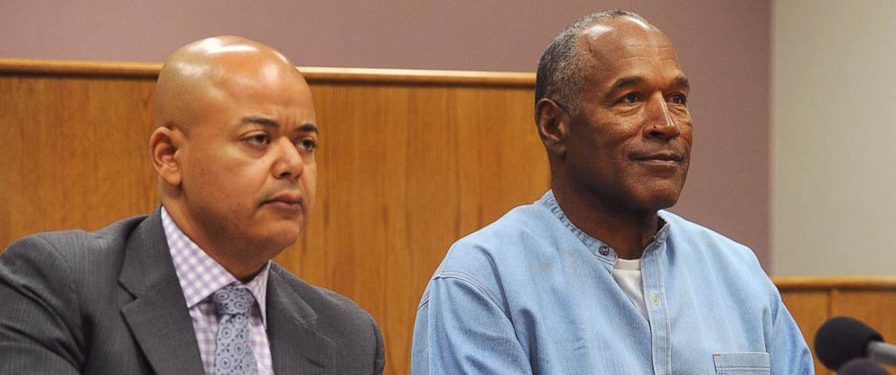 PHOTO: Former NFL football star O.J. Simpson appears with his attorney, Malcolm LaVergne, via video for his parole hearing at the Lovelock Correctional Center in Lovelock, Nev., on Thursday, July 20, 2017.