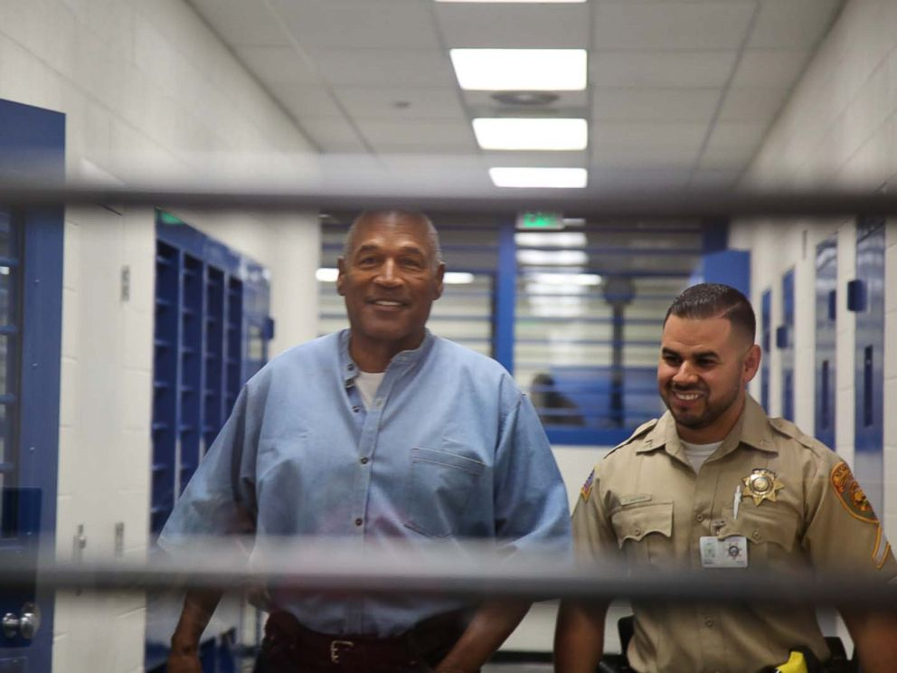 PHOTO: O.J. Simpson smiles as he approaches the parole hearing room to attend his hearing at the Lovelock Correctional Center in Lovelock, Nevada, July 20, 2017.